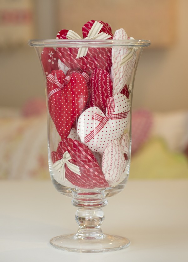 Glass vase filled with hearts